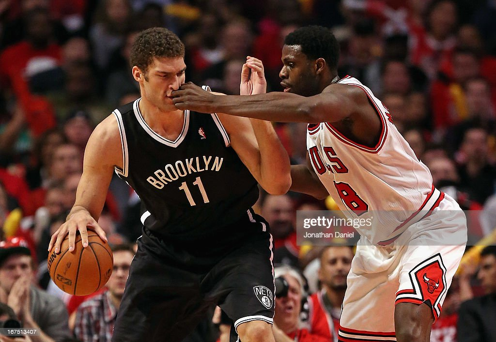 Nazr Mohammed of the Chicago Bulls hits Brook Lopez of the Brooklyn Nets in the face in Game Three of the Eastern Conference Quarterfinals during the...