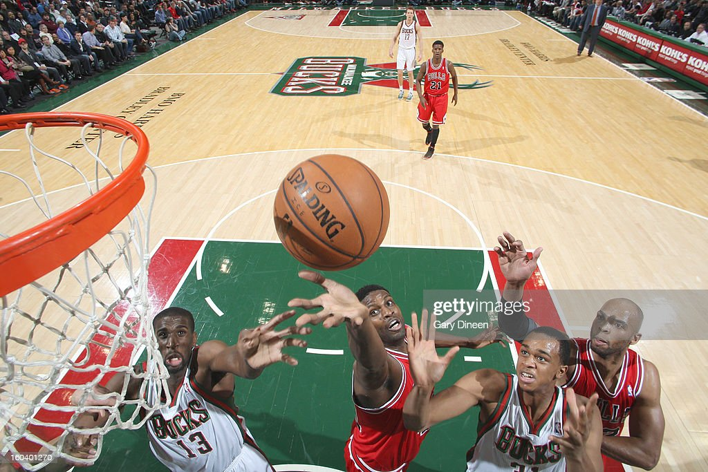 Nazr Mohammed #48 of the Chicago Bulls reaches for a rebound against (L-R) Ekpe Udoh #13 and John Henson #31 of the Milwaukee Bucks on January 30, 2013 at the BMO Harris Bradley Center in Milwaukee, Wisconsin.