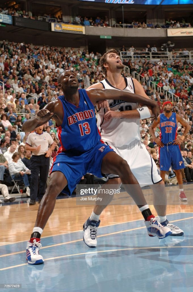 Nazr Mohammed #13 of the Detroit Pistons and Mehmet Okur #13 the Utah Jazz attempts to rebound the ball during the game on November 6, 2006 at the Delta Center in Salt Lake City, Utah. The Jazz won 103-101.