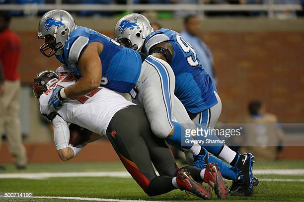 Ndamukong Suh and Ezekiel Ansah of the Detroit Lions sack Josh McCown of the Tampa Bay Buccaneers at Ford Field on December 07 2014 in Detroit...
