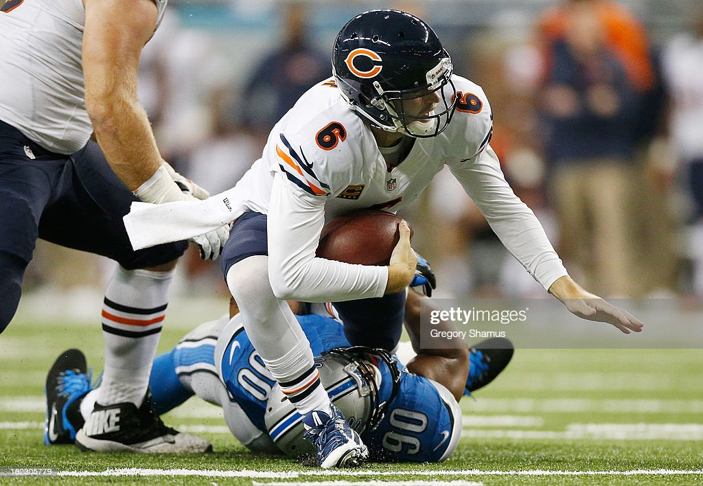 Ndamukong Suh of the Detroit Lions brings down Jay Cutler of the Chicago Bears at Ford Field on September 29 2013 in Detroit Michigan