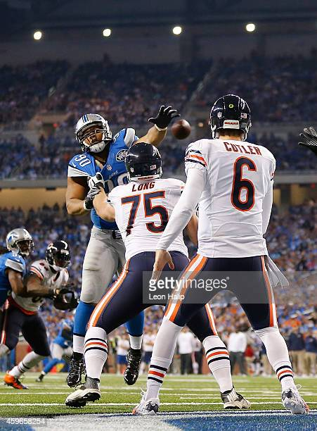 Ndamukong Suh of the Detroit Lions rushes quarterback Jay Cutler of the Chicago Bears during the fourth quarter of the game at Ford Field on November...