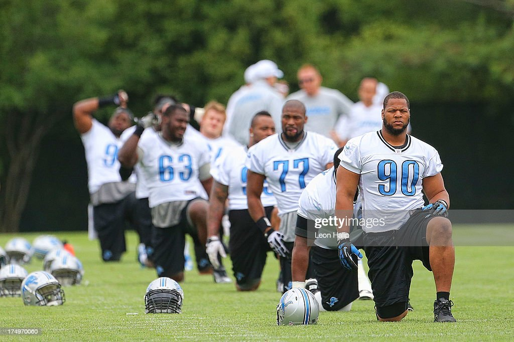 <a gi-track='captionPersonalityLinkClicked' href=/galleries/search?phrase=Ndamukong+Suh&family=editorial&specificpeople=5545543 ng-click='$event.stopPropagation()'>Ndamukong Suh</a> #90 of the Detroit Lions warms up prior to the start of the daily drills during training camp on July 29, 2013 in Allen Park, Michigan.