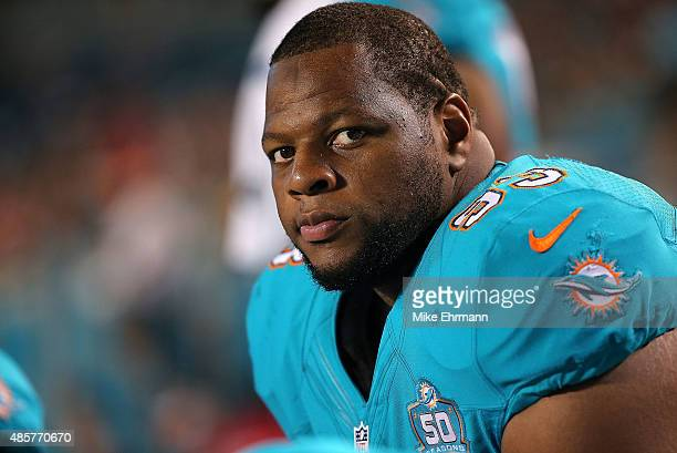 Ndamukong Suh of the Miami Dolphins looks on during a preseason game against the Atlanta Falcons at Sun Life Stadium on August 29 2015 in Miami...