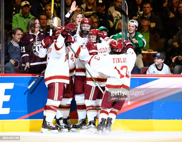 NDenver Pioneers forward Henrik Borgström is surrounded by teammates after his goal in the first period against the Notre Dame Fighting Irish on...