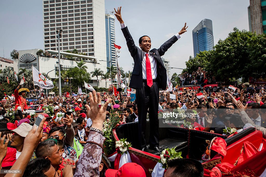 I ndonesian President Joko Widodo waves to the crowd while on his journey to Presidential Palace by carriage during the ceremonial parade on October 20, 2014 in Jakarta, Indonesia. Joko Widodo was sworn in October 20, as the president of Indonesia with an inauguration ceremony held in Jakarta. Widodo was the eventual winner of a tightly fought and sometimes controversial election race against opposition candidate Prabowo Subianto. A number of key world leaders were in attendance including Australia's prime minister Tony Abbott.