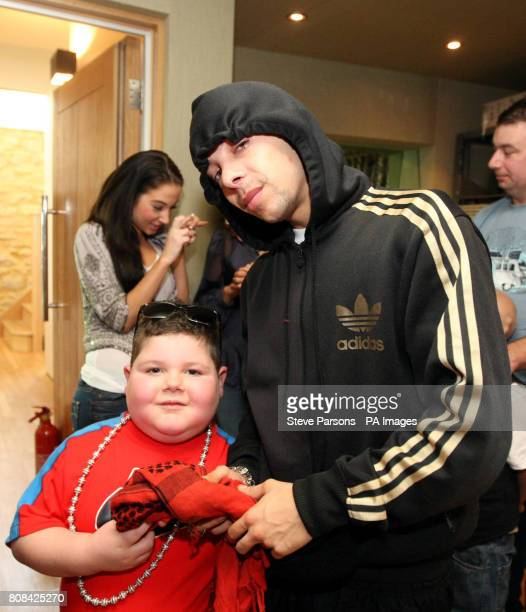 NDubz's Dino 'Dappy' Contostavlos with sixyearold Mark Sheppard from Glasgow who visited the Angelic Studios in Brackley after the charity Rays of...