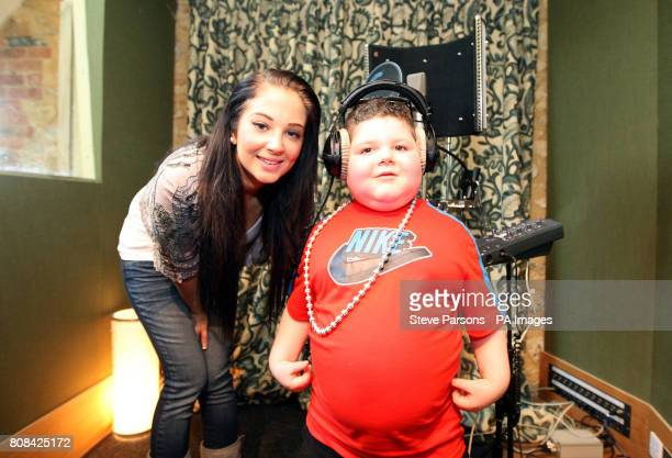 NDubz's Tula 'Tulisa' Contostavlos with sixyearold Mark Sheppard from Glasgow who visited the Angelic Studios in Brackley after the charity Rays of...