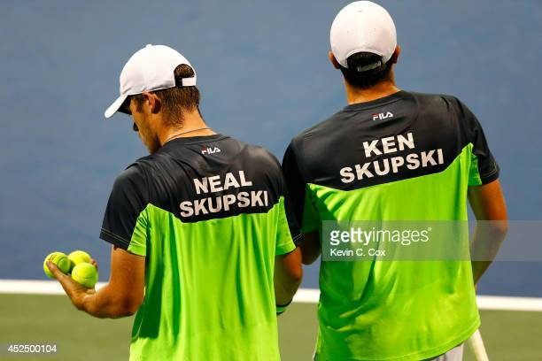 Neal and Ken Skupski of England converse between points against Robby Ginepri and Ryan Harrison during the BBT Atlanta Open at Atlantic Station on...