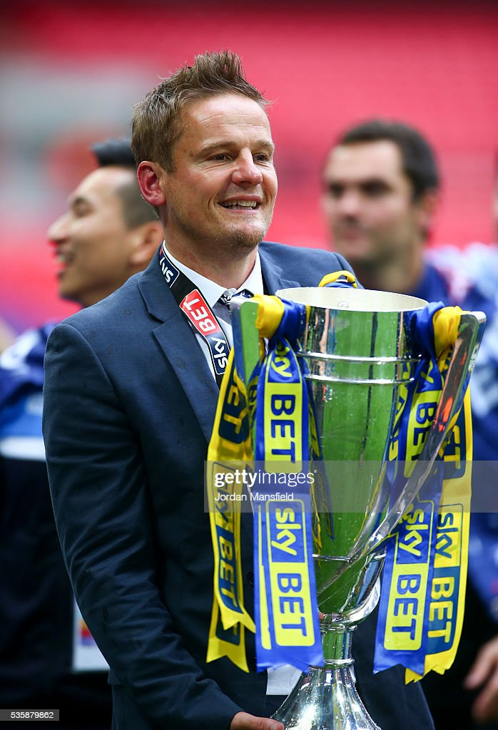 <a gi-track='captionPersonalityLinkClicked' href=/galleries/search?phrase=Neal+Ardley&family=editorial&specificpeople=2103824 ng-click='$event.stopPropagation()'>Neal Ardley</a>, manager of Wimbledon celebrates with the trophy after their victory in the Sky Bet League Two Play Off Final match between Plymouth Argyle and AFC Wimbledon at Wembley Stadium on May 30, 2016 in London, England.