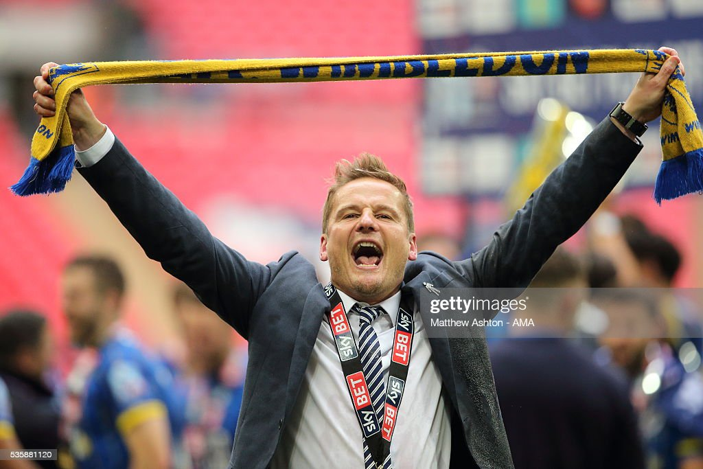 <a gi-track='captionPersonalityLinkClicked' href=/galleries/search?phrase=Neal+Ardley&family=editorial&specificpeople=2103824 ng-click='$event.stopPropagation()'>Neal Ardley</a> the head coach / manager of AFC Wimbledon celebrates promotion after victory in the Sky Bet League Two Play Off Final between Plymouth Argyle and AFC Wimbledon at Wembley Stadium on May 30, 2016 in London, England.