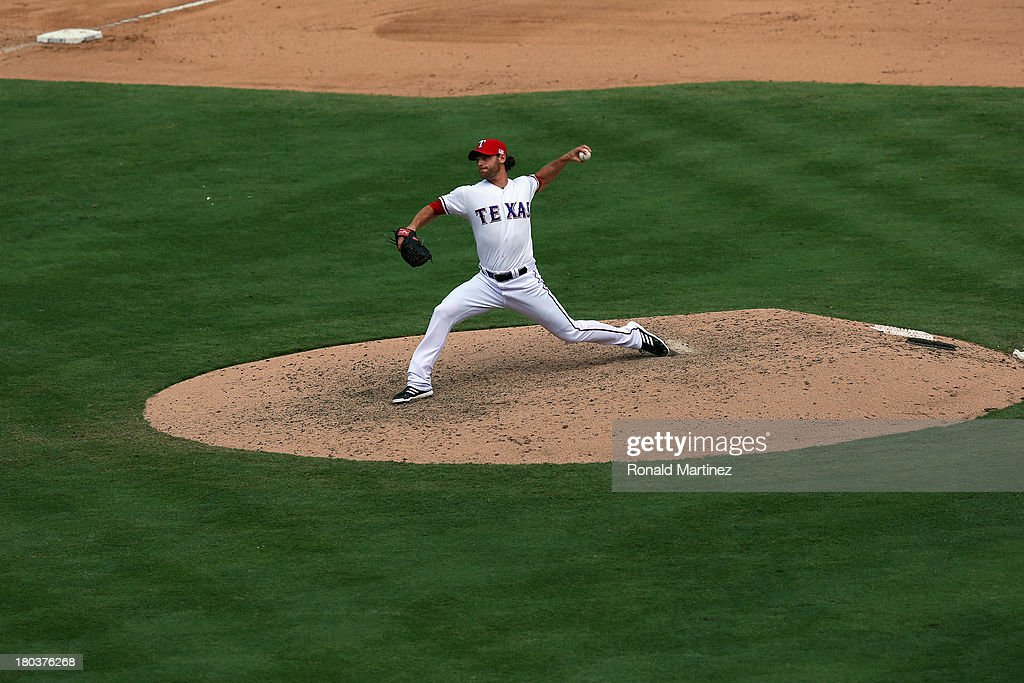 <a gi-track='captionPersonalityLinkClicked' href=/galleries/search?phrase=Neal+Cotts&family=editorial&specificpeople=213851 ng-click='$event.stopPropagation()'>Neal Cotts</a> #56 of the Texas Rangers at Rangers Ballpark in Arlington on September 11, 2013 in Arlington, Texas.