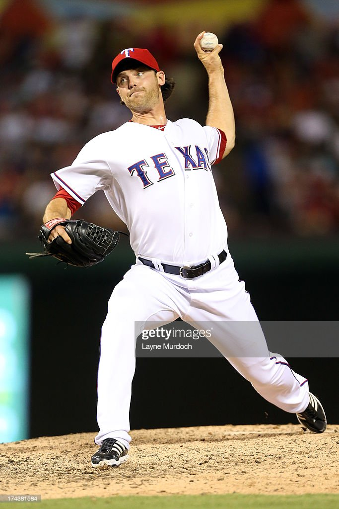 <a gi-track='captionPersonalityLinkClicked' href=/galleries/search?phrase=Neal+Cotts&family=editorial&specificpeople=213851 ng-click='$event.stopPropagation()'>Neal Cotts</a> #56, relief pitcher for the Texas Rangers pitches in the top of the eighth inning against the New York Yankees on July 24, 2013 at the Rangers Ballpark in Arlington in Arlington, Texas.
