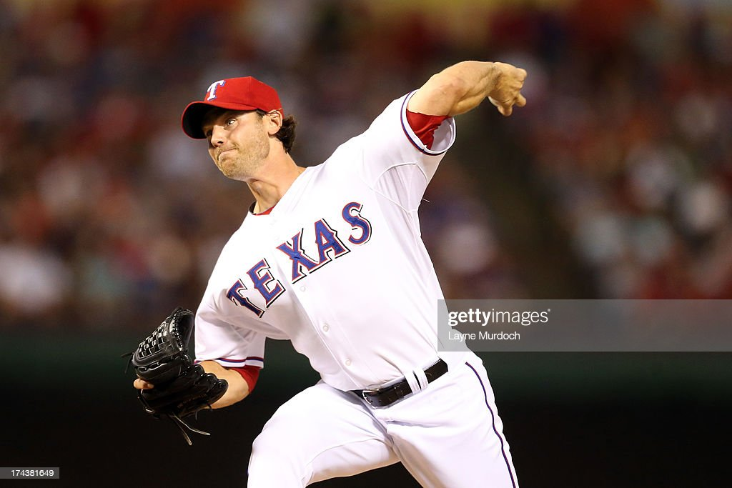 Neal Cotts #56, relief pitcher for the Texas Rangers pitches in the top of the eighth inning against the New York Yankees on July 24, 2013 at the Rangers Ballpark in Arlington in Arlington, Texas.
