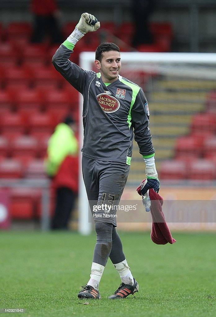 Neal Kitson of Northampton Town celebrates at the end of the match after saving a last minute penalty on his debut to ensure a draw during the npower League Two match between Crewe Alexandra and Northampton Town at The Alexandra Stadium on March 31, 2012 in Crewe, England.