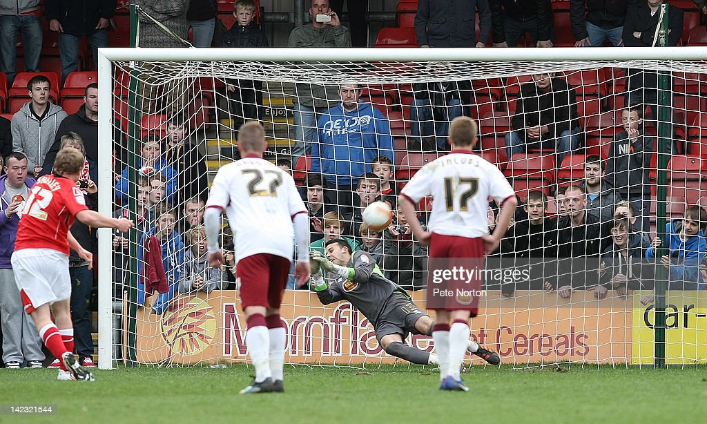 Neal Kitson of Northampton Town saves a penalty taken by Danny Shelley of Crewe Alexandra in the last minute of the game to ensure a draw during the npower League Two match between Crewe Alexandra and Northampton Town at The Alexandra Stadium on March 31, 2012 in Crewe, England.