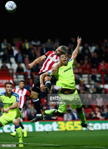 Neal Maupay of Brentford and Curtis Davies of Derby County battle for possession during the Sky Bet Championship match between Brentford and Derby...