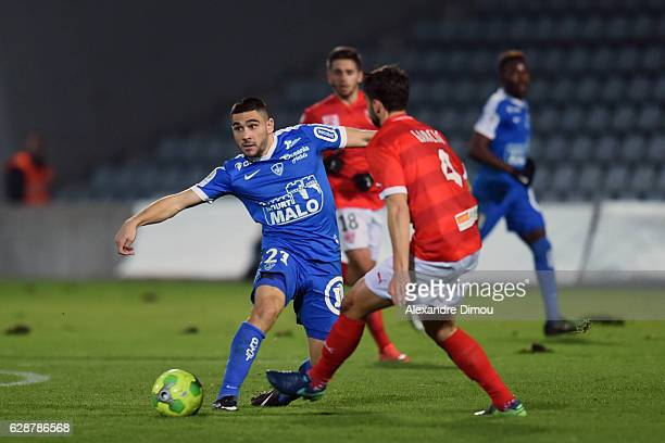 Neal Maupay of Brest and Fabien Garcia of Nimes during the French LIgue 2 match between Nimes and Brest at Stade des Costieres on December 9 2016 in...