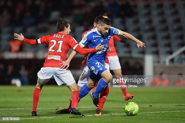 Neal Maupay of Brest and Fethi Harek of Nimes during the French LIgue 2 match between Nimes and Brest at Stade des Costieres on December 9 2016 in...