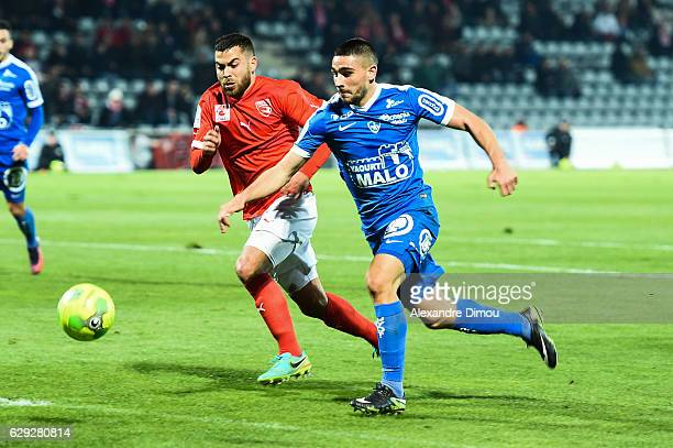 Neal Maupay of Brest and Tegi Savanier of Nimes during the French LIgue 2 match between Nimes and Brest at Stade des Costieres on December 9 2016 in...