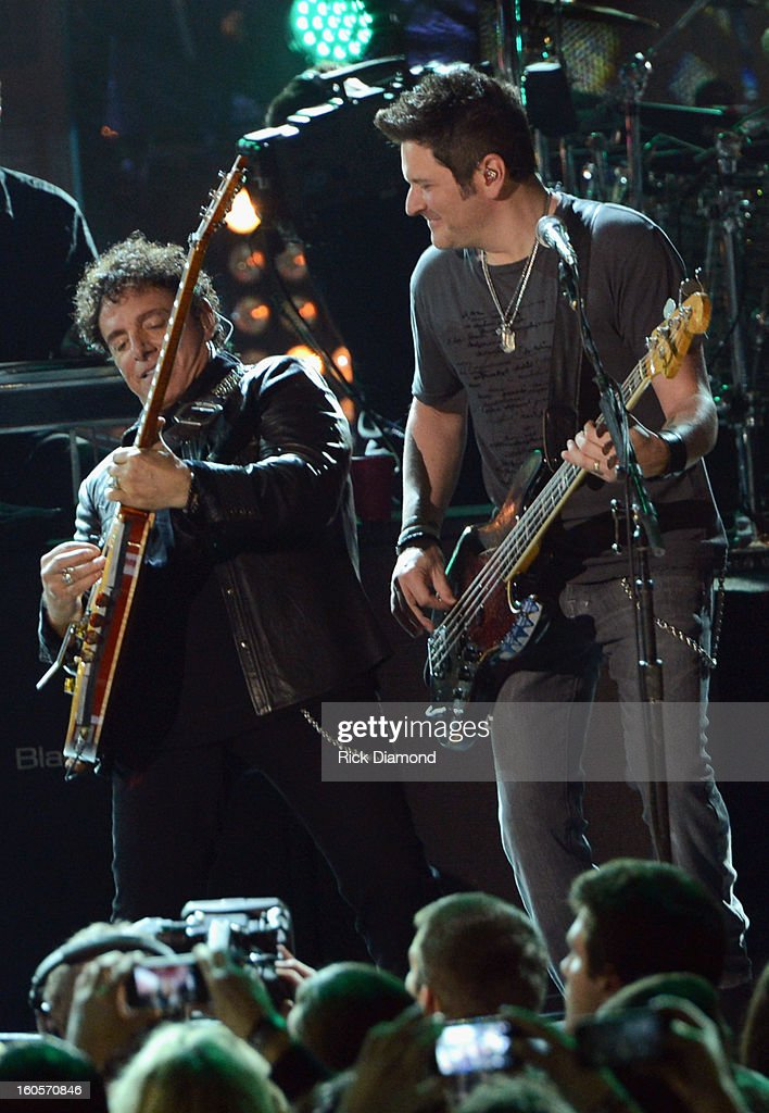 Neal Schon and Jay DeMarcus perform onstage as Journey and Rascal Flatts headline the Super Bowl XLVII CMT Crossroads Concert on February 2, 2013 in New Orleans, Louisiana.