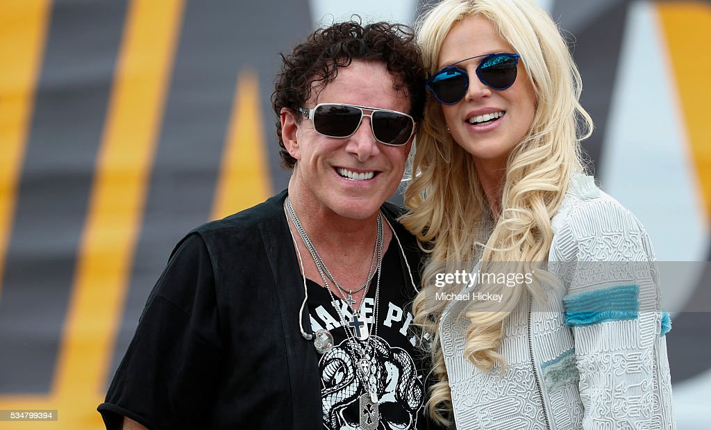 <a gi-track='captionPersonalityLinkClicked' href=/galleries/search?phrase=Neal+Schon&family=editorial&specificpeople=595042 ng-click='$event.stopPropagation()'>Neal Schon</a> and <a gi-track='captionPersonalityLinkClicked' href=/galleries/search?phrase=Michaele+Schon&family=editorial&specificpeople=6541122 ng-click='$event.stopPropagation()'>Michaele Schon</a> are seen backstage at the Indianapolis Motor Speedway on May 27, 2016 in Indianapolis, Indiana.