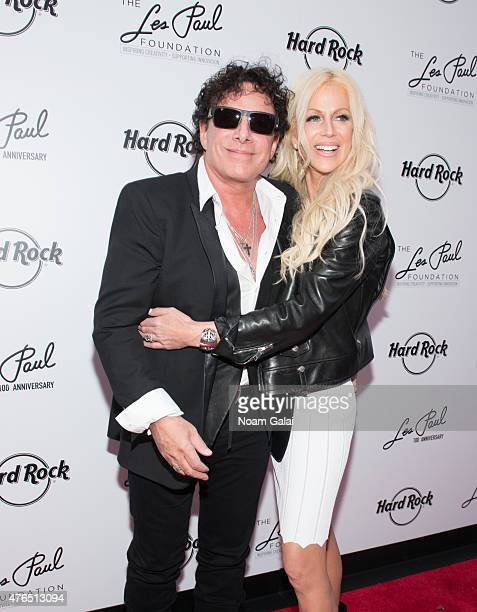 Neal Schon and Michaele Schon attend Les Paul's 100th anniversary celebration at Hard Rock Cafe Times Square on June 9 2015 in New York City