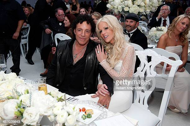 Neal Schon and Michaele Schon attend their wedding at the Palace of Fine Arts on December 15 2013 in San Francisco California