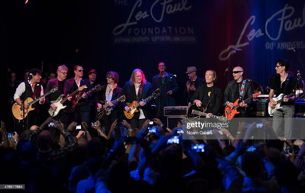 Neal Schon, Joe Bonamassa, Johnny A., Warren Haynes, G. E. Smith, Steve Miller, Joe Satriani and Steve Vai perform during Les Paul's 100th anniversary celebration at Hard Rock Cafe - Times Square on June 9, 2015 in New York City.