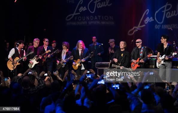 Neal Schon Joe Bonamassa Johnny A Warren Haynes G E Smith Steve Miller Joe Satriani and Steve Vai perform during Les Paul's 100th anniversary...