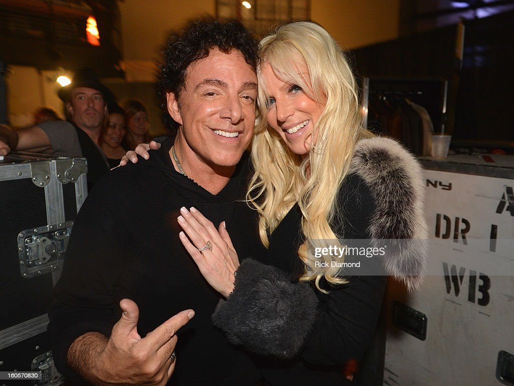 Neal Schon of Journey and Michaele Salahi are seen backstage as Journey and Rascal Flatts headline the Super Bowl XLVII CMT Crossroads Concert on February 2, 2013 in New Orleans, Louisiana.