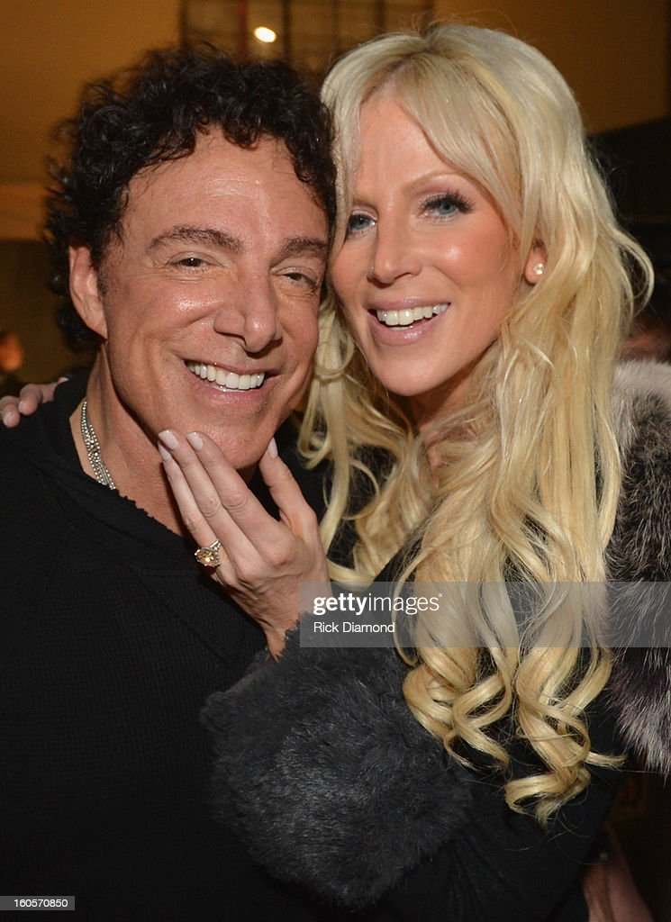 <a gi-track='captionPersonalityLinkClicked' href=/galleries/search?phrase=Neal+Schon&family=editorial&specificpeople=595042 ng-click='$event.stopPropagation()'>Neal Schon</a> of Journey and Michaele Salahi are seen backstage as Journey and Rascal Flatts headline the Super Bowl XLVII CMT Crossroads Concert on February 2, 2013 in New Orleans, Louisiana.