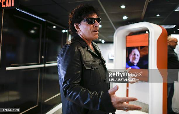 Neal Schon of the rock band Journey speaks to reporters during the opening ceremony of 'Les Paul Appreciation day' a yearlong celebration marking...