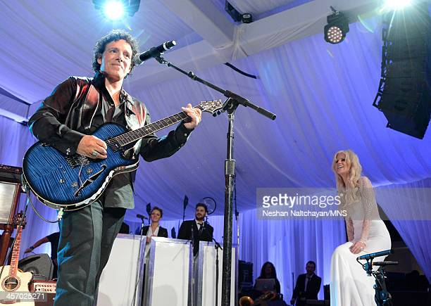Neal Schon performs for Michaele Schon during their wedding at the Palace of Fine Arts on December 15 2013 in San Francisco California