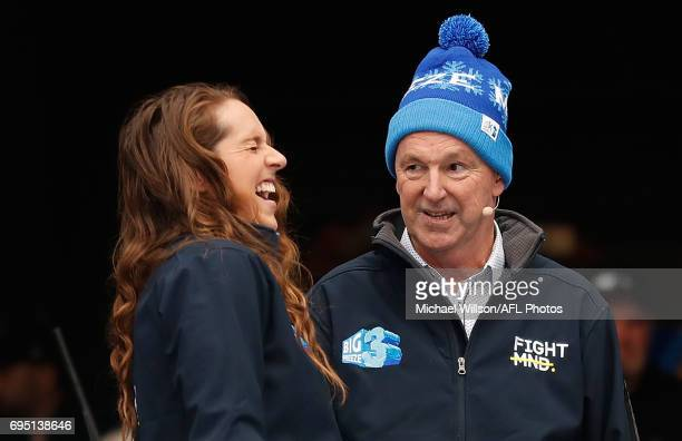 Neale Daniher and daughter Bec share a laugh as part of the Big Freeze 3 during the 2017 AFL round 12 match between the Melbourne Demons and the...