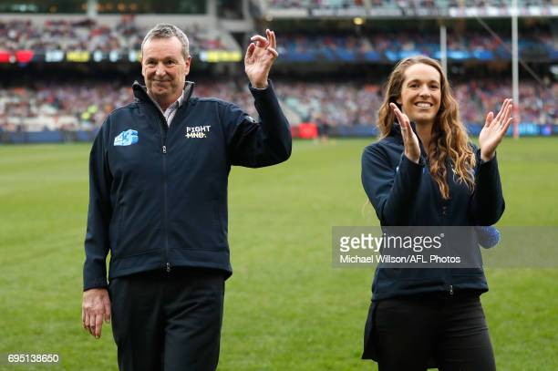 Neale Daniher and daughter Bec thank the crowd as part of the Big Freeze 3 during the 2017 AFL round 12 match between the Melbourne Demons and the...