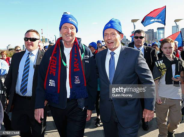 Neale Daniher and Prime Minister Tony Abbott walk to the MCG ahead of the round 10 AFL match between the Melbourne Demons and the Collingwood Magpies...