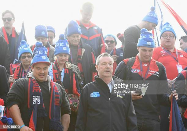 Neale Daniher leads the walk to the G for Freeze MND during the round 12 AFL match between the Melbourne Demons and the Collingwood Magpies at...