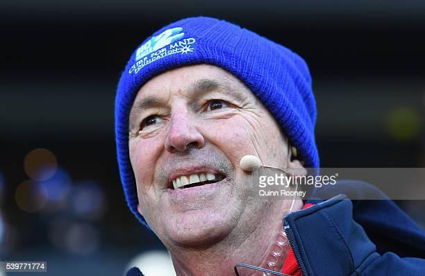 Neale Daniher looks on during the round 12 AFL match between the Melbourne Demons and the Collingwood Magpies at Melbourne Cricket Ground on June 13...