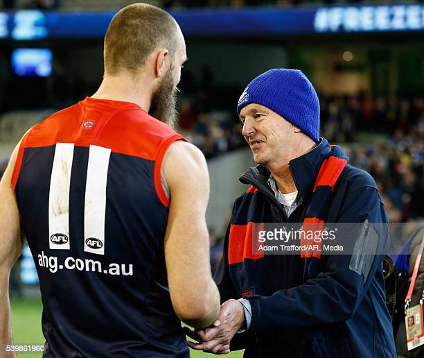 Neale Daniher presents the Neale Daniher Trophy to Max Gawn of the Demons during the 2016 AFL Round 12 match between the Melbourne Demons and the...