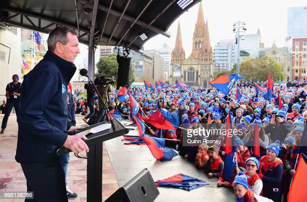 Neale Daniher speaks at Federation Square before leading the walk to the MCG for Freeze MND during the round 12 AFL match between the Melbourne...