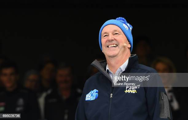 Neale Daniher watches the celebrities go down the Freeze MND slide during the round 12 AFL match between the Melbourne Demons and the Collingwood...