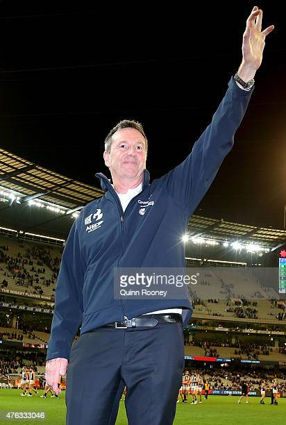 Neale Daniher waves to the crowd during the round 10 AFL match between the Melbourne Demons and the Collingwood Magpies at Melbourne Cricket Ground...