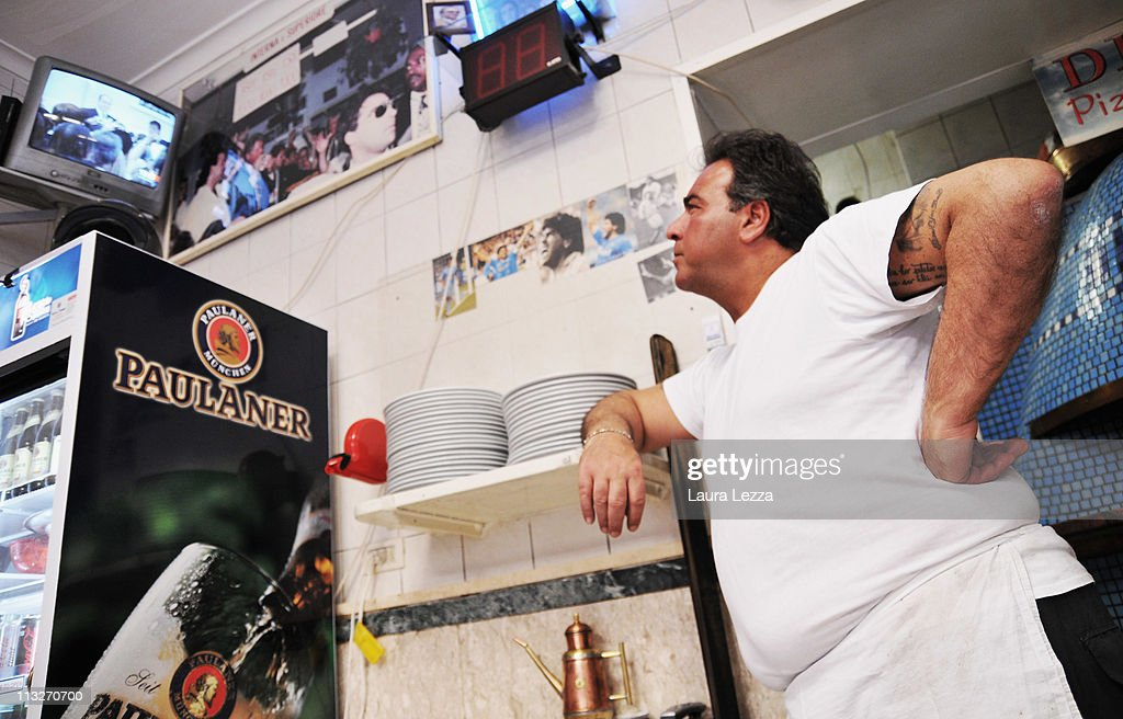 Neapolitan man watches the royal wedding of Prince William and Catherine Middleton, in his Pizzeria in the neighborhood of Forcella on April 29, 2011 in Naples, Italy.