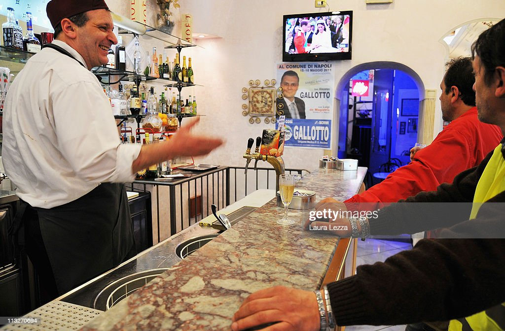 Neapolitan men watch the royal wedding of Prince William and Catherine Middleton, ina bar in the neighborhood of Forcella on April 29, 2011 in Naples, Italy.