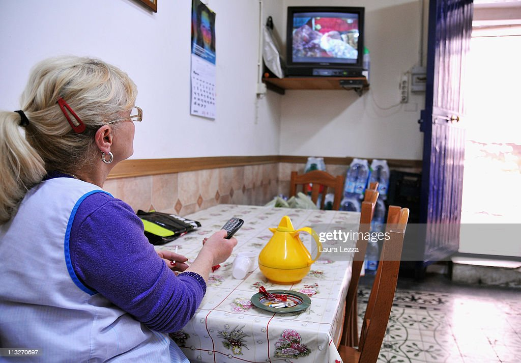 A Neapolitan woman watches the royal wedding of Prince William and Catherine Middleton, in her house in the neighborhood of Forcella on April 29, 2011 in Naples, Italy.