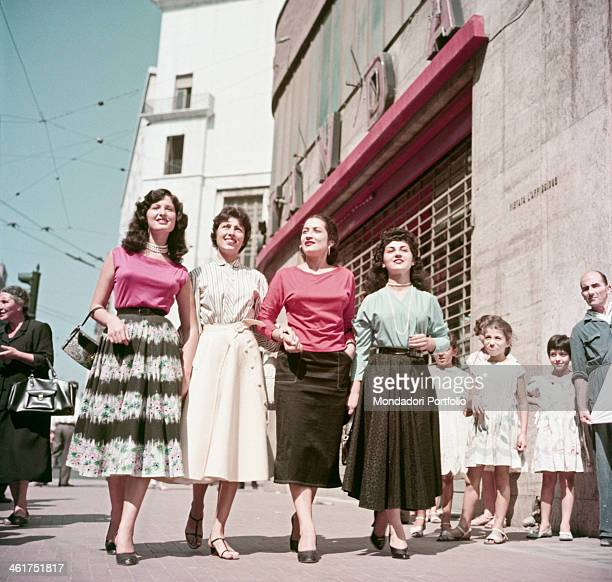 Neapolitan young women Maria Paolucci Elisa Villarosa Teresa Chianese and Immacolata Mazza walking in the streets of Naples Naples 1955