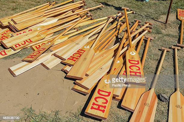 Near a tent for the DCH dragon boat team a pile of traditionallyshaped paddles used during the races sis on display The twoday 25th Annual Hong Kong...