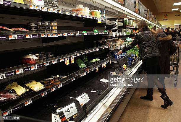 Near empty shelves are seen in the produce section at a supermarket on January 21 ahead of an expected blizard in Washington DC A blizzard warning...