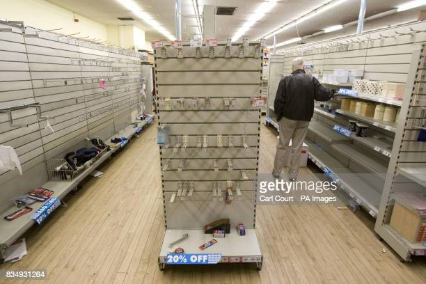 Near empty shelves at a Woolworths store in Camden London as the company struggles to find a buyer for its chain of stores